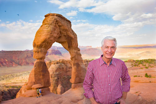 Dr. Fischer smiles brightly during a trip to Utah's famous Delicate Arch